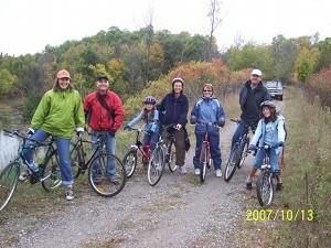 family-of-bikers-on-trail